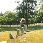 Owen fill his spreader  with mole poison at Carver, Fuqua, Gleaves Cemetery