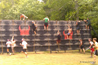 A blurry shot of some Warriors going over the wall.