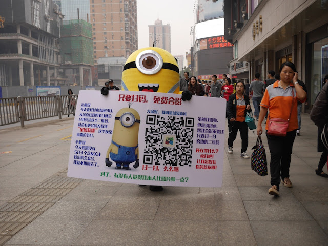 Minion mascot holding a sign in Changsha