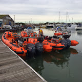 """Inshore lifeboats """"Malcolm & Mona Bennett-Williams"""" and """"Sgt Bob Martin (Civil Service No. 50) moored alongside at Cobbs Quay Marina, with crew member Lewis Singleton aboard the relief ILB - November 2013.  Photo credit: RNLI/Poole"""