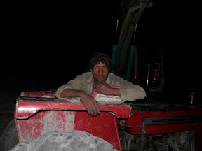 The sleepy tractor guy who guided us for our stopover.