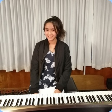 Hana Tani preparing to play the Clavinova CVP-509. Photo courtesy of Dennis Lyons.