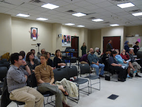 Audience gathers before forum. About 35 people attended Thursday evening's event