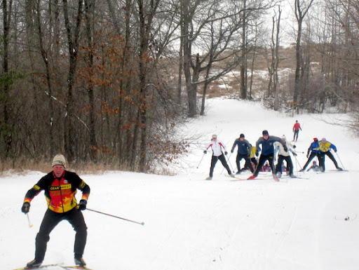 Coach Brad leading Wayzata skiers up Suicide.