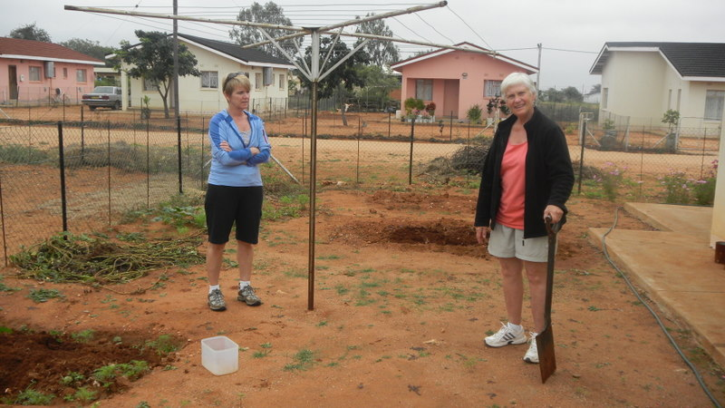 Mary showing Tish their compost pile