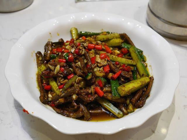 spicy eel dish with portion of a metal rice bucket in Hengyang, Hunan