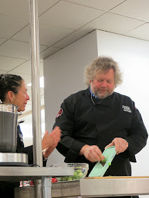 Culinary Council Recap: Nancy Silverton, Culinary Council member at the Macy's at Washington Square Dec 14, 2013, calls Tom Douglas into her service on the mandoline for the Brussels Sprouts for the Shaved Brussels Sprouts Salad