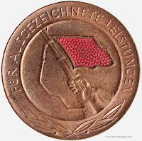 203b Medaille für ausgezeichnete Leistungen in den Kampfgruppen der Arbeiterklasse  www.ddrmedailles.nl