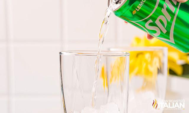 sprite pouring into a glass
