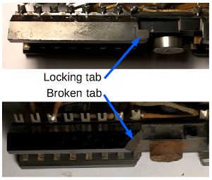 When the tube module slides sideways into the connectors, the locking tabs engage to keep it from being pulled out. In this tube module, the locking tabs are broken off.