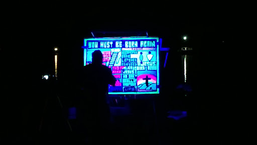It gets pretty dark at the Friday Night Campfire service. The sketch is painted with fluorescent paint that glows under a black light. It makes it both visible and memorable.