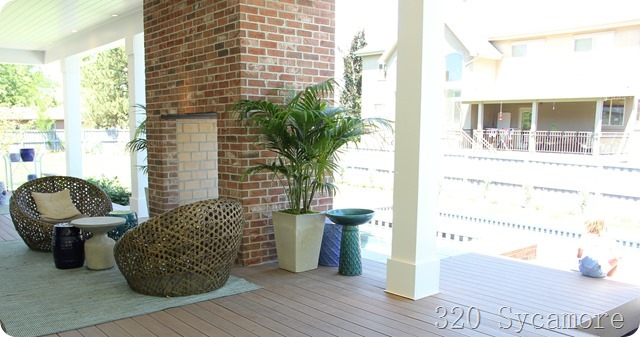 outdoor fireplace with hot tub on other side
