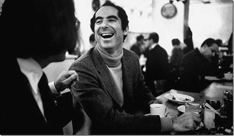 Author Philip Roth, revisiting areas where he grew up, sitting at lunch counter in Newark, New Jersey, talking to a customer.  (Photo by Bob Peterson/The LIFE Images Collection/Getty Images)