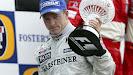 Kimi Raikkonen on podium for McLaren