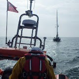 Poole ILB tows an 8m yacht with a fouled propellor in towards Poole Harbour from around 2 nautical miles off Handfast Point - 23/07/2013.  Photo credit: RNLI/Poole