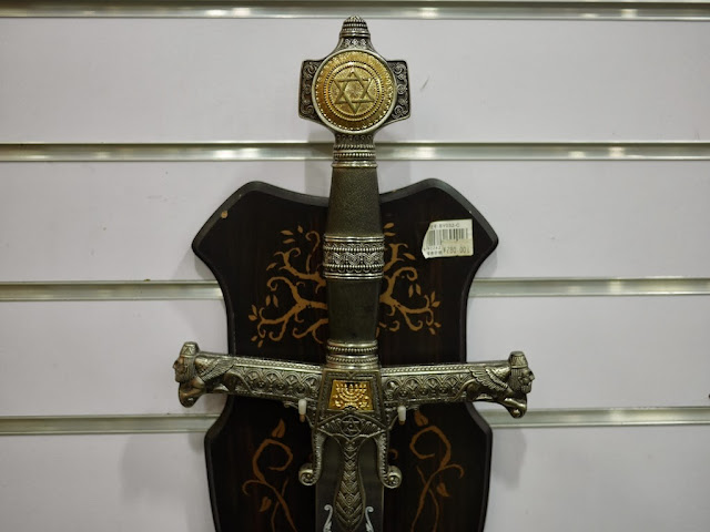 Star of David symbol on hilt of a sword for sale at Smart Wife Knives in Yangjiang, China