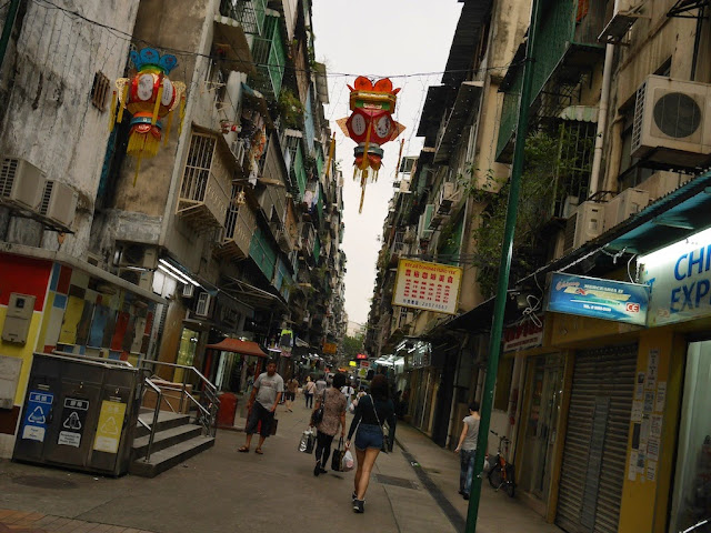 lanterns hanging over a pedestrian street in Macau's Three Lamps District