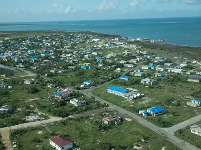 Aerial view of blue tarps stretched across buildings in Barbuda, after Hurricane Irma. This view shows the Samaritan's Purse tarps and Hydrovolt reverse osmosis water access point. Photo: Kim E Rowland / The Citizen-Times