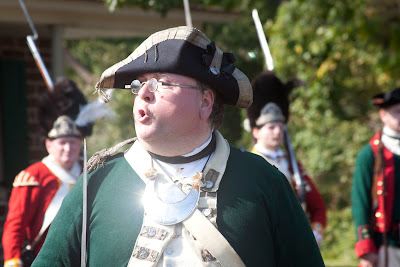 Todd of the historical society addessing the troops and throngs. Photos by TOM HART/  FREELANCE PHOTOGRAPHER.