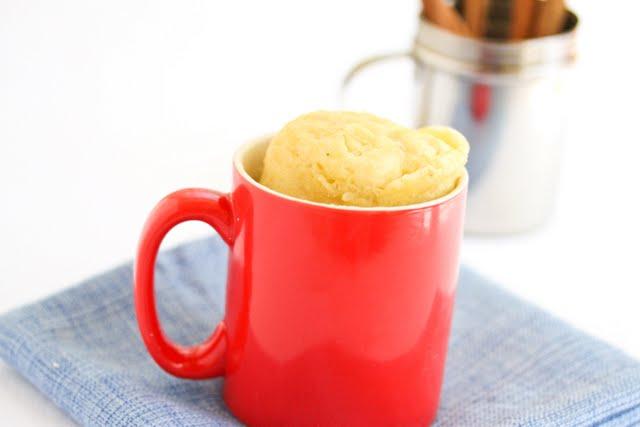 photo of a Banana Mug Cake in a red mug