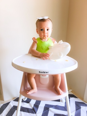 Apple Seated In Her Baby Bjorn High Chair.