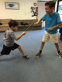 students use violin bow as fencing epee or sword