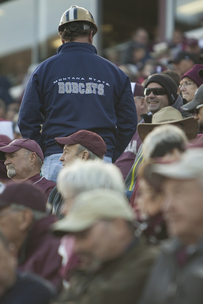 A lone Montana State fan braves the sea of maroon in seating section 104 on Saturday.  Washington-Grizzly Stadium in Missoula, Mont., November 17th, 2012.