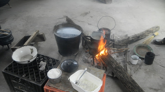 Where Dube cooks his food and heats our water