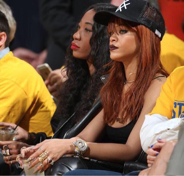 Rihanna in Lucid FC Trucker Hat, BAPE Hoodie