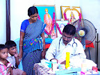 Dr.S.Shanmugasundaram attending a patient :: Date: May 14, 2007, 11:13 AMNumber of Comments on Photo:0View Photo