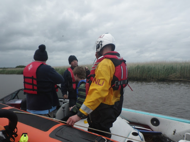 8 June 2012: ILB crew member Rob Inett discussing the situation with the speedboat's crew. Photo: RNLI Poole/Dave Riley