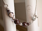 Yummy marble chocolate necklace with toggle clasp on front.