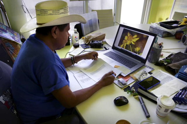 Max Munoz,, Grounds Manager at the National Butterfly Center, catalogs flowers found at the center. Plans are for Trump's border wall to be built along the levee that will cut The National Butterfly Center in half. The NBC is near Mission, TX. Photo: Bob Owen / San Antonio Express-News