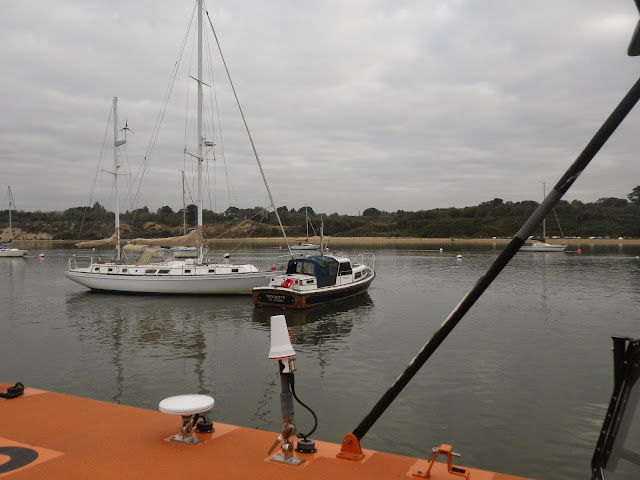 Poole ALB arrives on scene where a motorboat has drifted against another vessel on a mooring off Lake Pier, Poole Harbour. 27 September 2014 Photo: RNLI Poole/Anne Millman