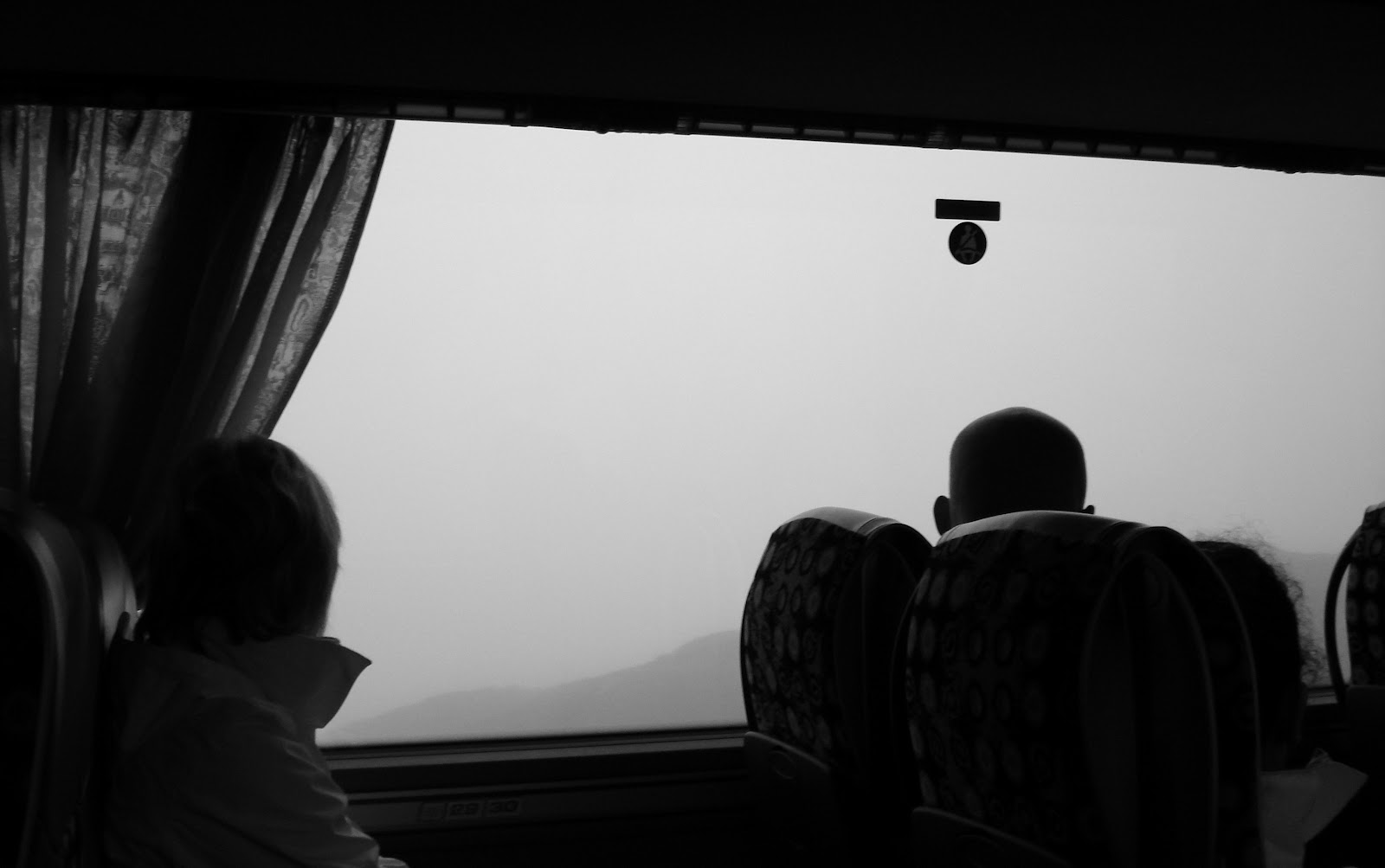 The bus on the way to Kjerag surrounded by fog.