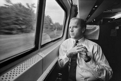 photo of Joe Biden commuting on a train in 1988. By Joe McNally.