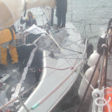 With no cleats to fasten the tow ropes to, the crew had to use winches and other fittings to attach the spring and breast ropes - and lots of fenders! Photo: RNLI Poole/Anne Millman