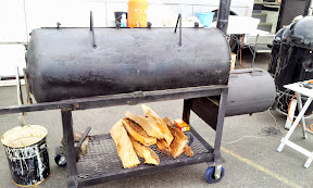 The BBQ teams invest in some serious equipment and wood