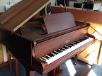 Spencer baby grand piano