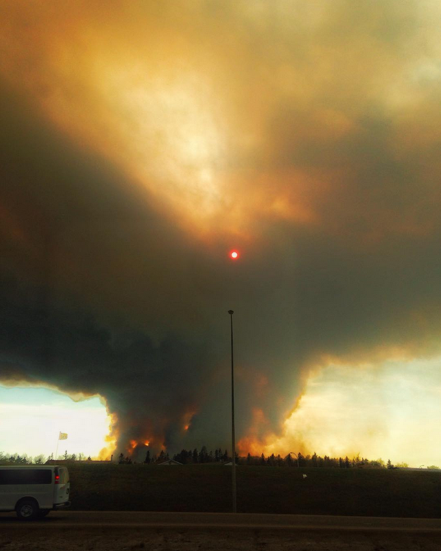 The sun shines through dense smoke from fires at Fort McMurray, Alberta, 3 May 2016. Photo: Ben Bennett / Instagram