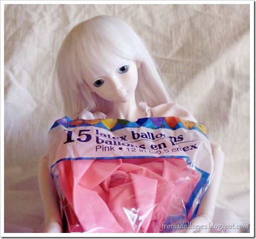Ball Jointed Doll Holding Latex Balloons
