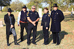 Members of the Fort Worth Police Historical Association gather for the grave dedication of the late officer.
