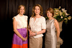 Luncheon co-chairs Layne Pitzer, left, and Joan Eleazer, right, with Her Majesty Queen Noor.