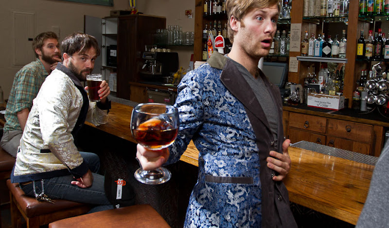 Navy and Gray Drinking Jackets sip beers at bar