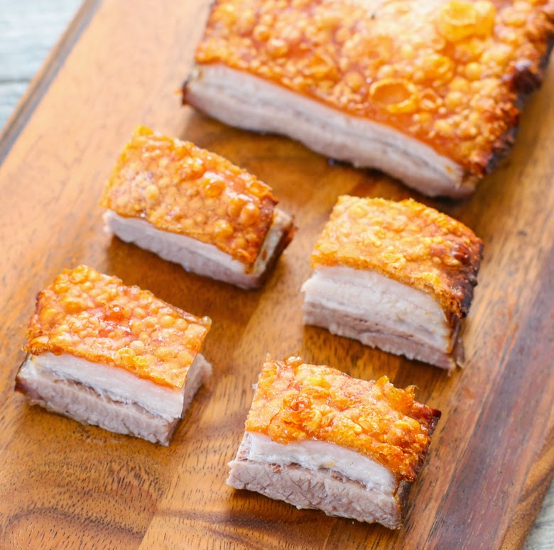 overhead photo of four slices of pork belly