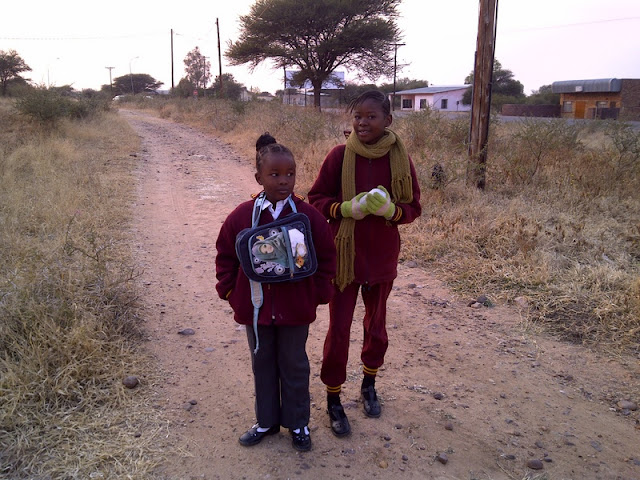 Two kids on the way to school, seen on the way to work