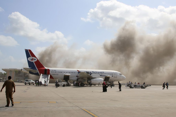 Dust rises after explosions hit Aden airport, upon the arrival of the newly-formed Yemeni government in Aden, Yemen, on December 30 2020.