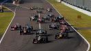 Romain Grosjean, Lotus E21 Renault, leads the field towards the first corner