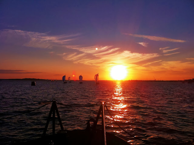 Gorgeous! Sunset and full moon (or two?) rising as Poole all-weather lifeboat comes back through Poole Harbour towing a 9.5m motor sailing vessel. 19 August 2013 Photo: RNLI/Dave Riley