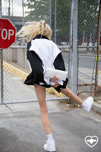 Hanne Gaby; model; dancing in the street; monochrome; black and white;